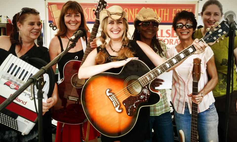 The Atomic Nightingales - Alyson�Poston Fahl on keyboards, Susan Jackson on violin, accordion, guitar and vocals, Wendy Elizabeth Jones on guitar and vocals, Mona Lawrence on drums, Victoria Logan on bass and Mary Allen on guitar and vocals.