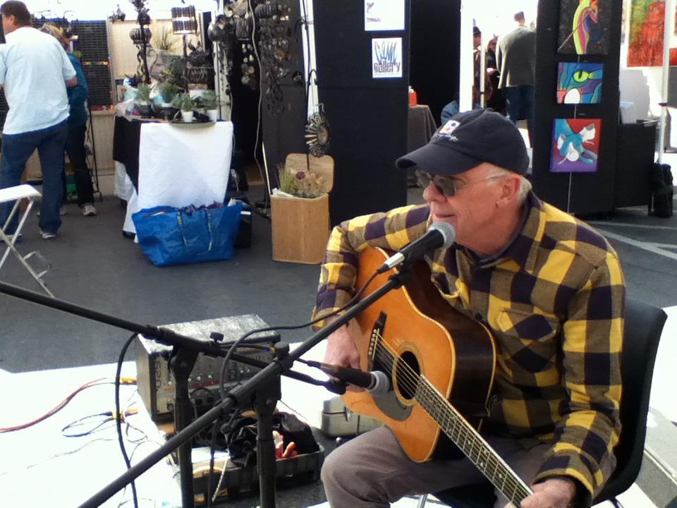 Sean Walters performing at the market.